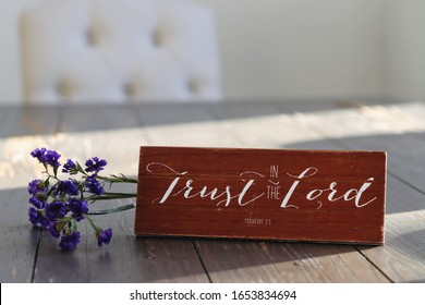 Christian wooden sign to trust in the lord.