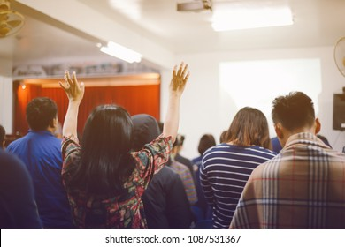Christian worship with raised hand at church