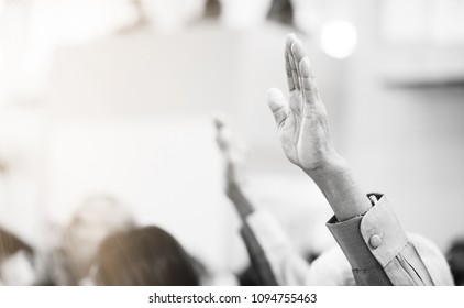 Christian worship with raised hand in church.black and white tone.