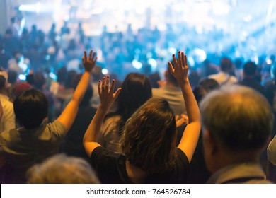Christian worship with raised hand and pray in the worship concert.