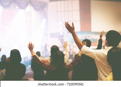 Christian worship with raised hand,music concert - Shutterstock ID 710599342