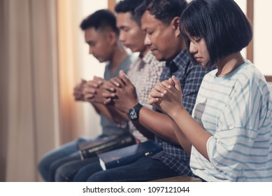 Christians and Bible study concept. Group of discipleship Studying the Word Of God in church and Christians praying together