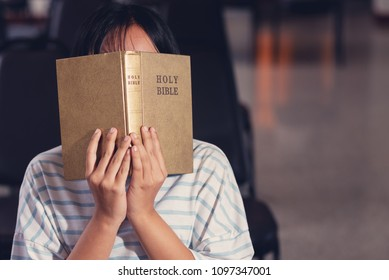 Christians and Bible study concept.Asian girl christians studying the word of god in church and praying