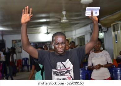 CHRISTIANS HAVING A PRAISE AND WORSHIP SESSION IN A LAGOS CHURCH, NIGERIA - NOVEMBER 18, 2016: Christians having a praise and worship session in a church, in Lagos Nigeria on November 18, 2016