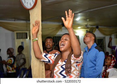 CHRISTIANS HAVING A PRAISE AND WORSHIP SESSION IN A LAGOS CHURCH, NIGERIA - NOVEMBER 18, 2016: Christians having a praise and worship session in a church, in Lagos Nigeria on November 18, 2016