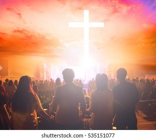 Christians prayed together in the church  on the sunset sky