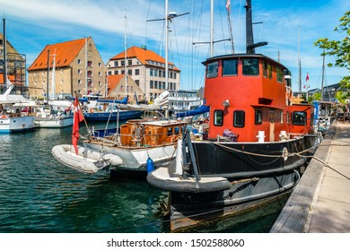Christianshavn channel with colorful buildings and boats in Copenhagen, Denmark.