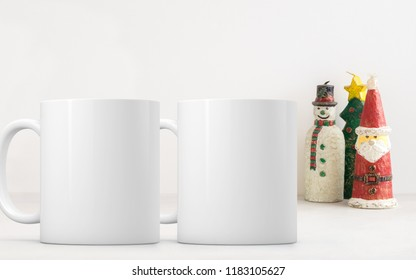 Christmas 2 mug mock-up. Two white blank coffee mugs to add custom design or quote. Perfect for businesses selling mugs, just overlay your quote or design on to the image.