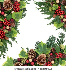 Christmas abstract background border with red and gold bauble decorations, holly, ivy, pine cones, cedar cypress and fir leaf sprigs over white.