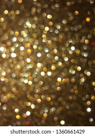 Christmas abstract gold light defocused Background and small bokeh