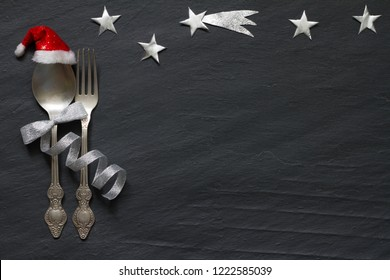 Christmas abstract table with silver cutlery and stars in night on marble black background