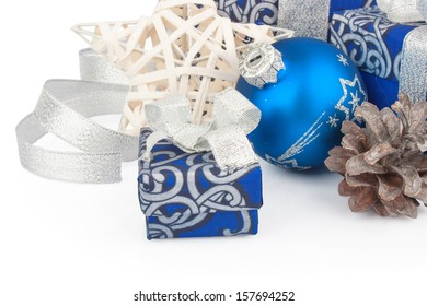 Christmas accessories & cone in blue, boxes, balls and star on white