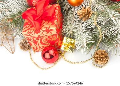 Christmas accessories in red & fir tree branch on white