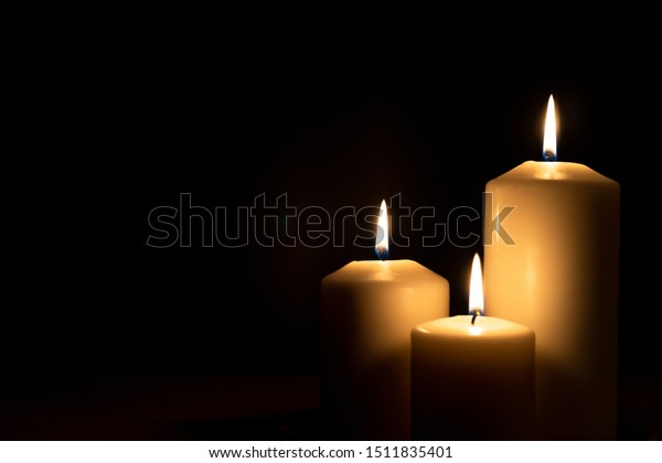 Christmas advent candle light in church with blurry golden bokeh for memorial day religious ritual, spiritual zen meditation, peaceful mind and soul or funeral worship ceremony