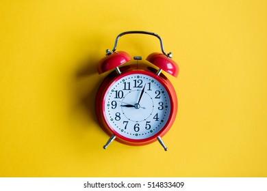 christmas alarm clock on yellow background