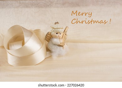 Christmas angel on the golden background