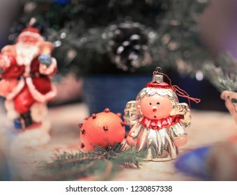 21ab0dfde5c00 Christmas angel and Santa Claus on the decorated holiday table