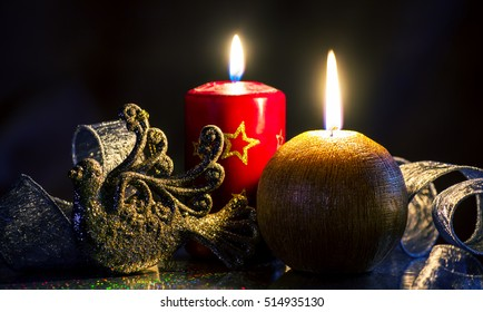 Christmas arrangement of candles and shiny decor, greeting card. Merry Christmas and Happy New Year