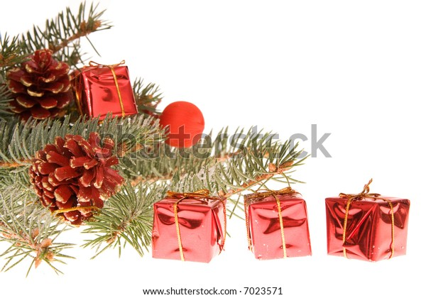 Christmas arrangement of conifer, gifts and cones