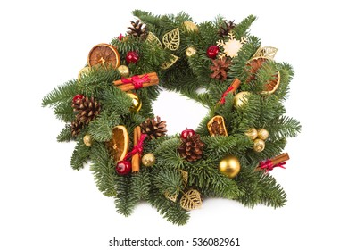 Christmas arrangement of natural fir branches. Stacked circle on a white background. Christmas wreath. The view from the top