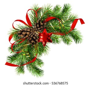 Christmas arrangement with pine twigs, cones and red silk ribbon bow isolated on white