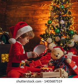 Christmas attributes. Family holiday. Childhood memories. Santa boy celebrate christmas at home. Boy child play christmas decorations. Merry and bright christmas. Childhood activity and game.