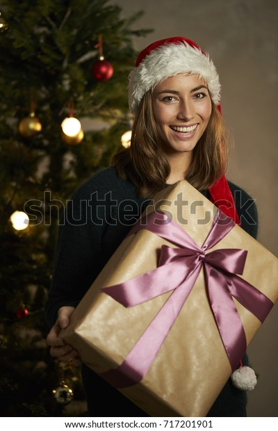 Christmas Babes.Christmas Babe Gift Wrapped Present Smiling Stock Photo