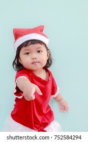 Christmas baby girl in Santa hat.Christmas holiday celebration concept.