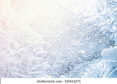 christmas background - abstract frozen water, structure of ice on sunrise