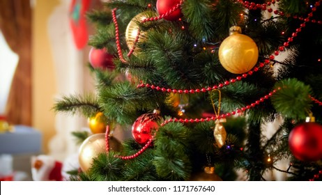 Christmas background with adorned fir tree in living room with fireplace