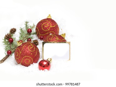 Christmas background with christmas balls and blank note
