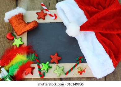 Christmas background with blank chalkboard for copy space and Christmas decorations.