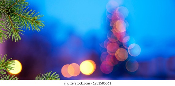 Christmas background. Blue background with needles of christmas tree.