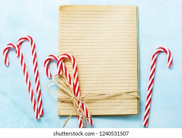christmas background, book for recipe and candycanes