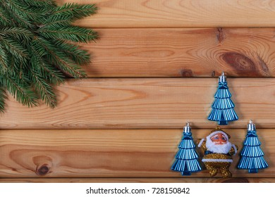 Christmas background with branches of Christmas tree and toys in the background/Christmas background with Christmas tree branches and toys on wooden background