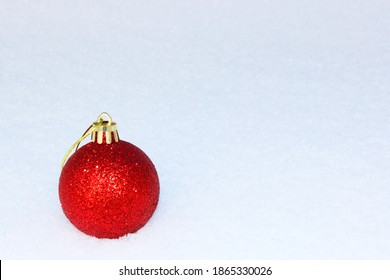 Christmas background with colored Christmas balls, Christmas toys, balls, decorations on a white snow background Merry Christmas theme of winter holidays. in the snow with gentle boke Close-up. Copy
