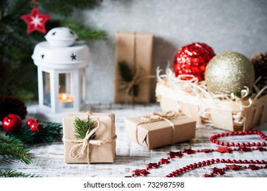 Christmas background. Christmas composition. Christmas gift, pine cones, fir branches on wooden white background