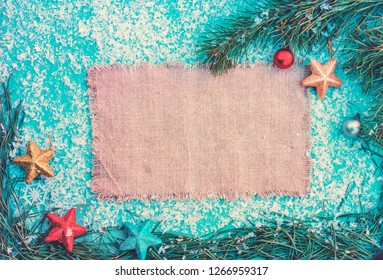 Christmas background. Composition from sackcloth, fir tree needles, snow and sackcloth