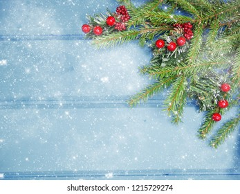 christmas background and cones decoration with fir branches on wooden board