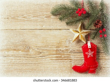 christmas background with cowboy shoe decoration toys.Wood texture for text