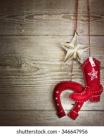 christmas background with cowboy western toys on wood texture