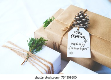 Christmas background - Craft and handmade Christmas present (gift boxes) with tag. Vintage style. Selective focus and shallow.