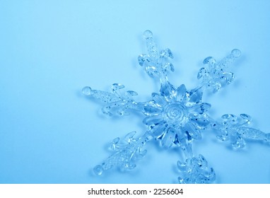 Christmas background with Crystal snowflake toning in blue color