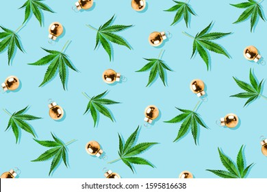 Christmas background, Christmas decor. Pattern of hemp leaves, cannabis and Christmas decorations on a blue background.