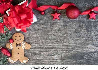 Christmas background decorate with gift boxes, christmas ball, ribbon bow and red ornament with gingerbread man cookie on vintage wooden table with copy space, Greeting card merry xmas happy new year