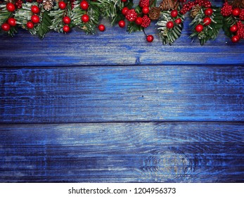 christmas background and decoration with fir branches garland lights on old wooden board copy space