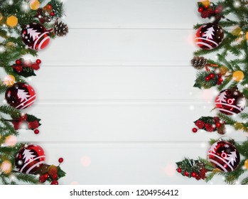 christmas background and decoration with fir branches garland lights on white wooden board