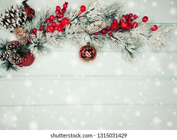christmas background and decoration with fir branches snow on  wooden board