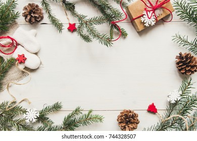 Christmas background. Christmas decoration with fir branches and gift on the wooden white table. Copy space