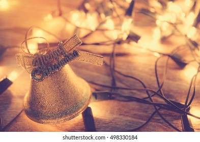 Christmas background with Christmas decoration shine bells with ribbon bows on a wooden table background with copy space, Grunge style,